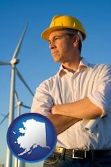 alaska map icon and an electrical engineer, with windmills in the background