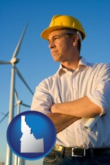 idaho map icon and an electrical engineer, with windmills in the background