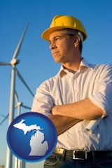 michigan map icon and an electrical engineer, with windmills in the background