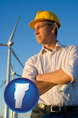 vermont map icon and an electrical engineer, with windmills in the background