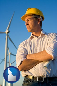 an electrical engineer, with windmills in the background - with Idaho icon