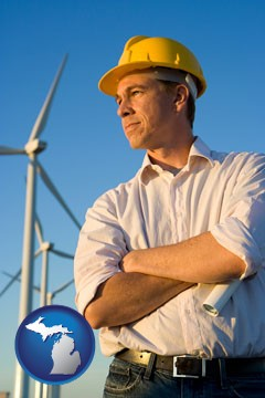 an electrical engineer, with windmills in the background - with Michigan icon