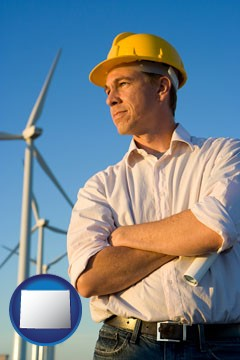 an electrical engineer, with windmills in the background - with Wyoming icon