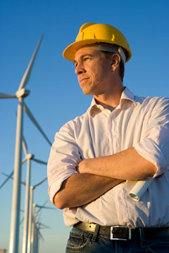 an electrical engineer, with windmills in the background
